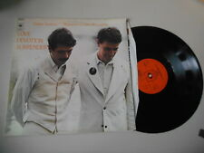 LP ROCK CARLOS SANTANA/JOHN McLaughin-Love DEVOUEMENT Surrender (5 chanson) CBS
