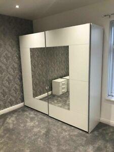 Rauch Sliding Door Wardrobe, Metallic Grey & White German Bedroom Furniture.