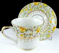 "GERMAN PORCELAIN #10177 YELLOW FLORAL AND GOLD 3 1/8"" FOOTED CUP AND SAUCER"