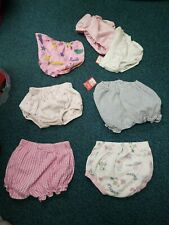 7 different pattern diaper covers (used) sized 3-6 diaper size