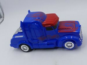 """BATTERY OPERATED ELECTRONIC 8"""" ROBOT TRUCK TRANSFORMING WORKING"""