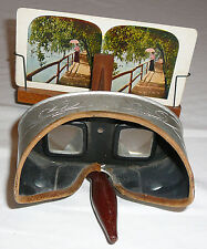 Underwood & Underwood Sun Sculpture antique stereoscope and 27 assorted cards