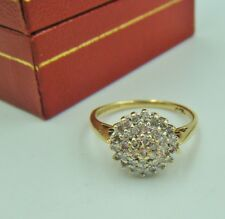 A 9ct Gold English Hallmarked Diamond Cluster Set Ring.