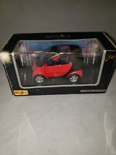 MAISTO SMART 1:33 RED MOTORIZED PULL-BACK CAR