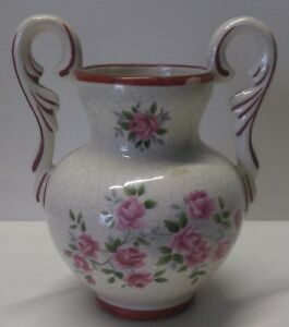 TWO HANDLED VASE WITH PRINTED CRAZING AND RED TRIM.      A10