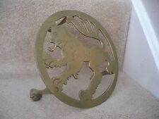 A VINTAGE BRASS GRIFFIN / LION TRIVET OR DISPLAY STAND AN OUTSTANDING ITEM.