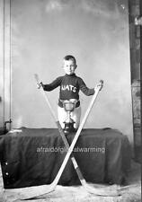 "Photo 1919-20 Vancouver Canada ""Boy Holding Hockey Sticks - Trophy"""
