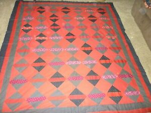 ANTIQUE EARLY RED AND BLACK QUILT TOP  INCLUDING 2 SIZES OF HORSESHOE FABRIC