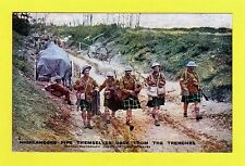 Official War Photograph. Highlanders pipe themselves back from the trenches