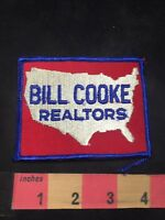 Vtg (circa 1970s) BILL COOKE REALTORS Advertising Patch O80N