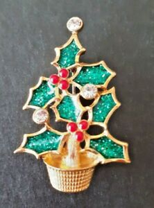 "Signed Vintage ""Avon"" Christmas tree brooch. Gold metal, clear stones, enamel."