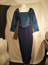Stiletto Ladies Suit with a Navy Blue Skirt with a Navy Blue and Aqua-marine Top