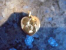 belle  medaille en forme de coeur des amoureux de peynet ....