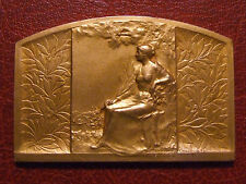 Art Deco woman seated palm branch in hand gold plated medal by René BAUDICHON