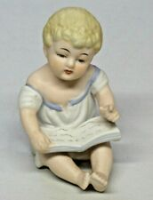 Vintage Bisque Piano Baby Figurine Sitting Reading Book Numbered 23/114