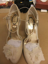 """Ivory satin shoes by Debut with ankle strap and flower/pearl detail.S7.Heel 4""""."""