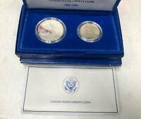 1886-1986 U.S. LIBERTY COINS HALF DOLLAR & SILVER DOLLAR SET W/ BOX & COA