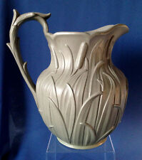 Large 1835 Ridgway green stoneware pitcher with molded bulrush / cattails design