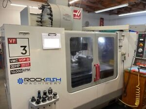 Haas VF-3D VMC, 10,000 RPM, P-Cool, SO, RJH, Side mt 24 ATC, and Auger.