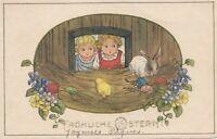 Pauli Ebner   Children see Easter rabbit with coloured eggs