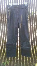 Black leather HEIN GERICKE German motorcycle pants; fully lined with boot flare;