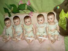 Orig. 1930s signed Madame Alexander, set of FIVE compo. DIONNE quint baby dolls