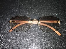 Cartier wood frame glasses