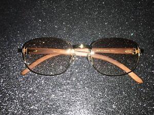 Cartier wood frame glasses