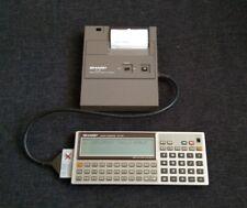 Vintage Pocket Computer SHARP PC-1350 and mobile printer SHARP CE-126P Japan