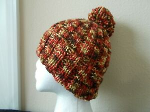 Hand knitted elegant and warn pom pom beanie/hat, yellow/brown/rusty tones
