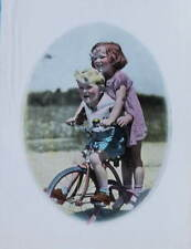 Vintage 1930s print Boy and Girl on old fashioned trike