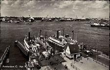 Amsterdam Niederlande alte s/w AK 1954 Blick auf die Anlegestelle Fähren Schiffe