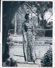 Lovely Asian Woman Models Dress & Pants Holding Sunglasses Press Photo