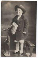 1915 RPPC Postcard Cicero Ill of Girl holding Box of Marshmellows w/ Toy Horse