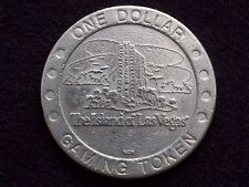 "$1 SLOT GAMING TOKEN -- TROPICANA CASINO -- ISLAND OF LAS VEGAS -- ""OBSOLETE"""