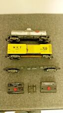 Lot of American flyer cars, track, accessory switches and power pack.