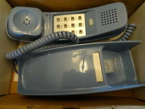 Brand new blue Premier push button wall telephone