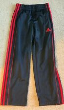 """A*""  ADIDAS youth size 8 black and red warmup pants"
