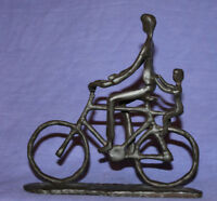 Vintage hand made metal artwork bicyclist statuette