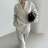 ivory power suit loose padded shoulder blazer and wide leg trousers suit set UK8