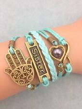 Bracelet bleu main de Fatma sister, coeur avec perle nacré et  lien infini
