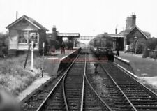 PHOTO  TRIMLEY RAILWAY STATION VIEW WITH A DMU IN VIEW FROM THE CAB OF AN APPROA
