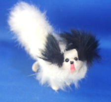 An antique fur covered Pomeranian, Papillon dog figure, salon dog, fashion doll