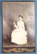 Victorian era cabinet card photo of long haired lady on a swing from Waco, Texas