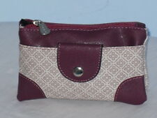 A Soft Wrist Purse With Top Zip Front Pocket Back Zip Pocket By Lorenz.