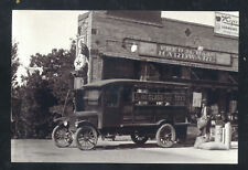REAL PHOTO FRED HAAS HARDWARE STORE ADVERTISING DOWNTOWN POSTCARD COPY