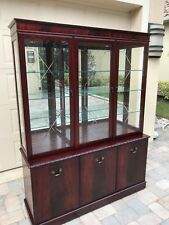 Glass wall unit for dining room in Burgundy , great condition