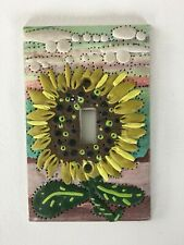 Artisan Switchplate Sunflower made with sculpy clay.
