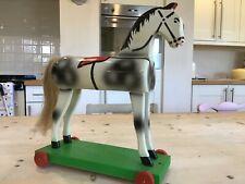 Antique vintage wooden horse on wheels,wooden platform pull along toy horse.