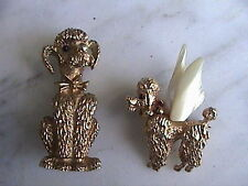 2 Poodle pins broochs one is 14k with angel wings, the other is signed boucher